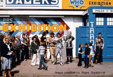 Crowds gather as a Cyberman is unmasked